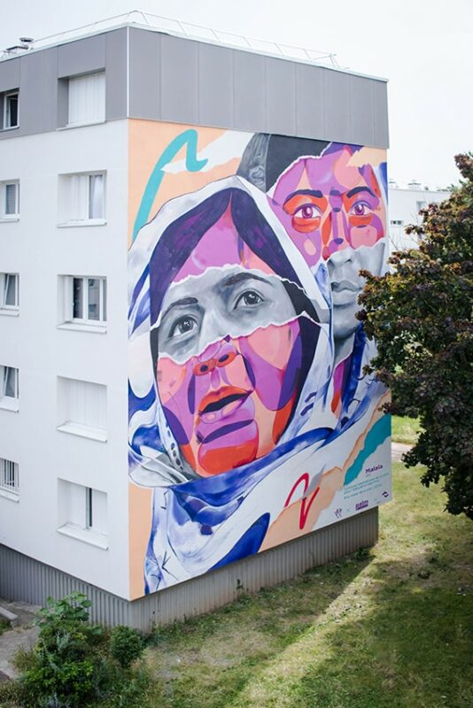 Palm a réalisé une fresque de 150m² sur la façade d'un immeuble avec Seine Saint Denis Habitat en hommage à Malala